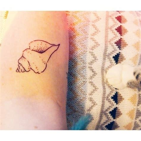 conch shell tattoo of a conch shell b o d y a r t