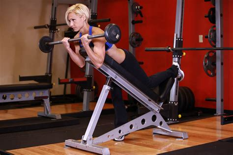 incline bench bicep curls barbell curls lying against an incline exercise guide and