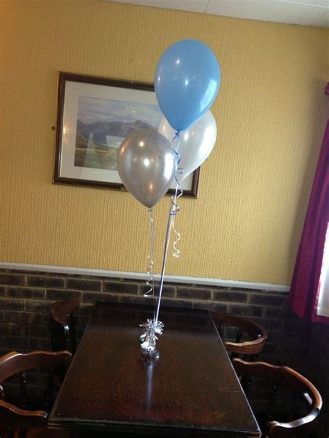This simple pale blue, white and silver balloon bouquet