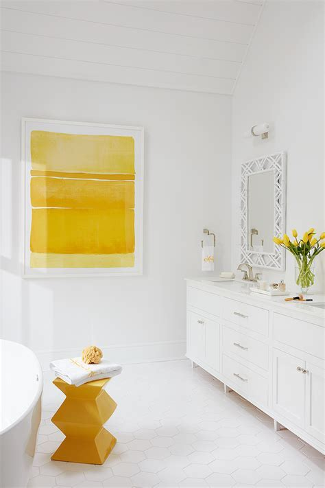 White and Yellow Bathroom with Claw Foot Tub