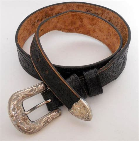 worn black leather western belt with ranger buckle set