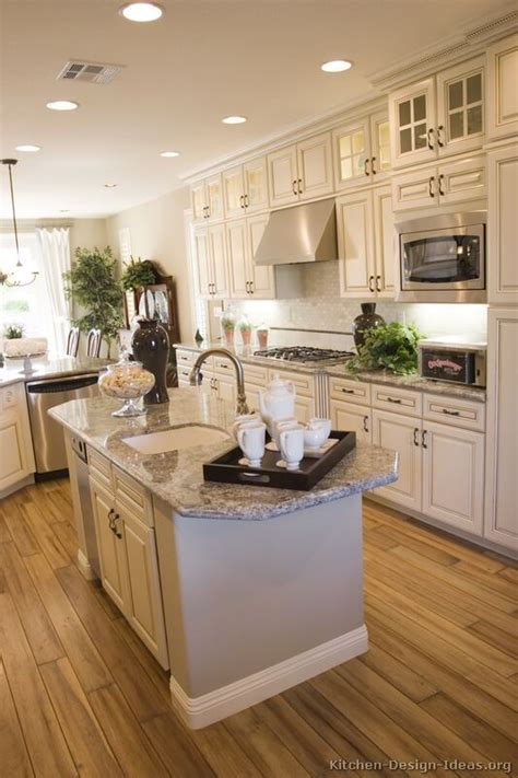 white kitchens with islands antique white kitchen with wood floors and an island sink