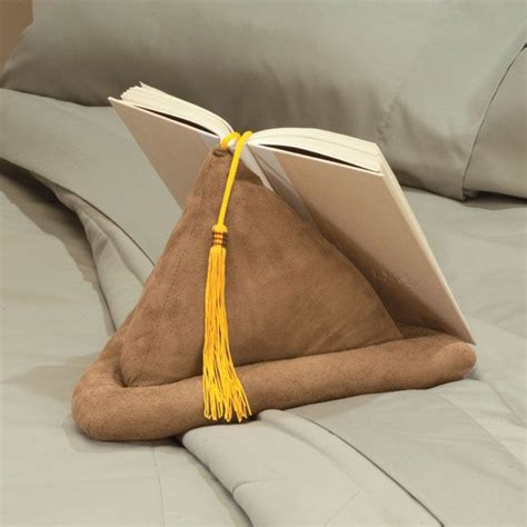 my pillow keeps moving books pyramid shaped book pillow with attached bookmark holds