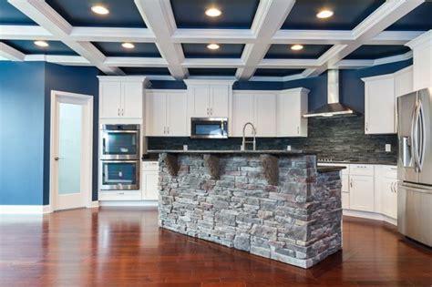 blue  white coffered ceiling stone island white cabinets slate backsplash msi steel grey