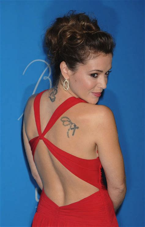 alyssa milano s 7 tattoos meanings steal her style alyssa milano back tattoo alyssa milano tattoos pictures