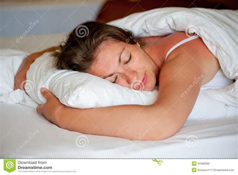comfortable positions to sleep in girl sleeping in a comfortable position stock photography