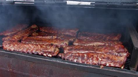 barbecue ribs cooking on a large smoker wagon stock footage video 736552 shutterstock