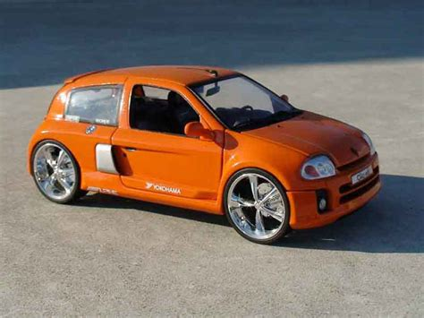 renault clio v6 white renault clio v6 orange universal hobbies diecast model car