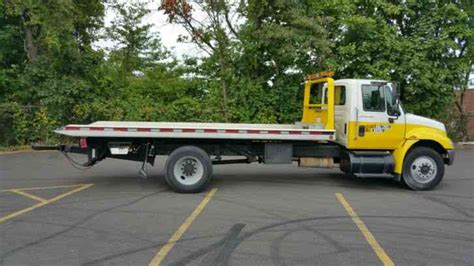 tow truck bed international 4200 2006 flatbeds rollbacks