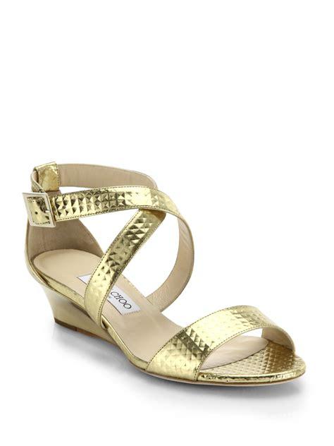 metallic gold sandals lyst jimmy choo chiara metallic leather wedge sandals in