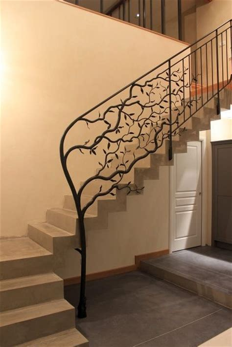 tree branch banister wrought iron tree sculpture morphs into a traditional
