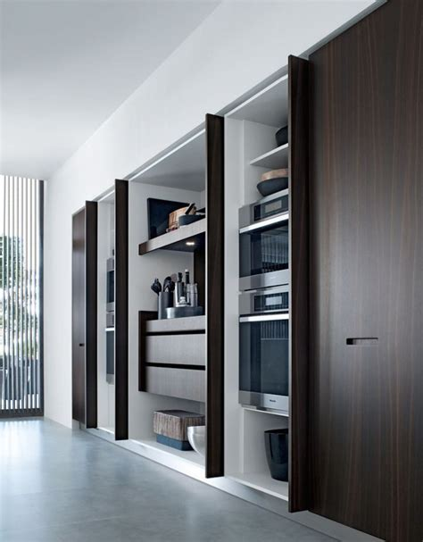 pocket doors in kitchen cabinetry perfect for hiding a tv the hidden kitchen fdk design