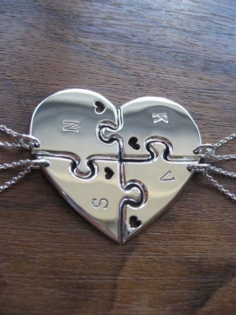 four best friend pendant necklaces with hearts