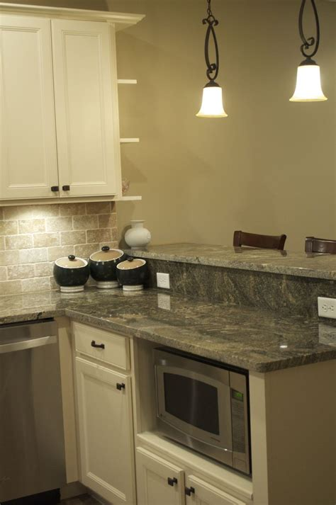 best granite color for white cabinets cmh builders antique white cabinets with built in