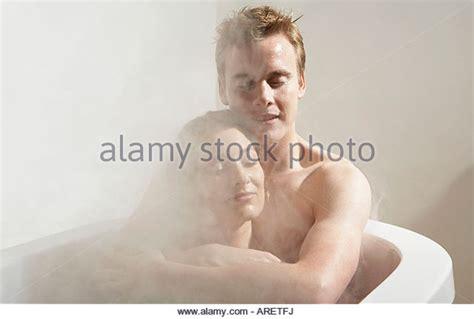 man and woman in bathroom man in a bathtub stock photos man in a bathtub stock