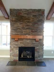 attractive Living Room Statues #1: Rustic-Stone-Veneer-Fireplace-for-Open-Room-Decoration-with-Black-Box-also-Shelf.jpg