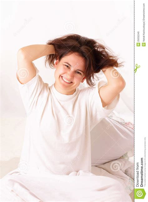 sitting in bed funny young woman sitting in bed stock photo image 25032240
