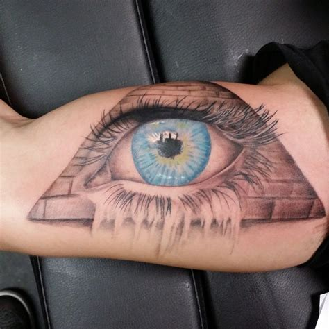 cross tattoo under eye meaning bicep tattoos for designs ideas and meaning tattoos