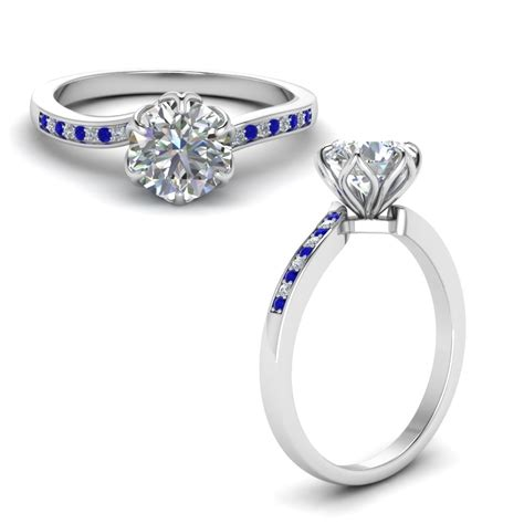 six prong floral engagement ring with sapphire in