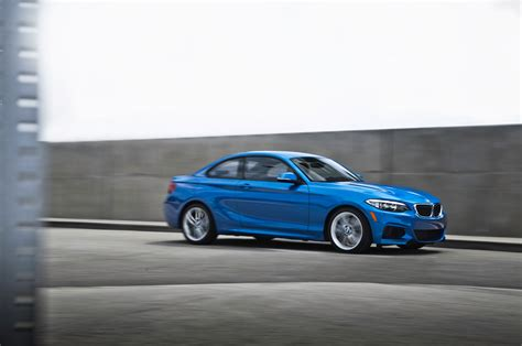 2014 bmw 228i coupe front three quarter in motion photo 16