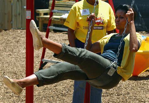 swings dc michelle obama helps build playground at dc charter school