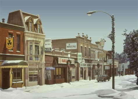 stock photo small town commercial street with snow and christmas decorations