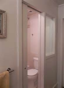 pocket door frosted window separating toilet in narrow