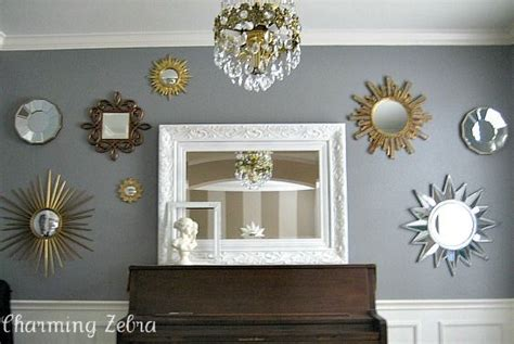 gallery wall around tv sunburst mirror gallery wall for