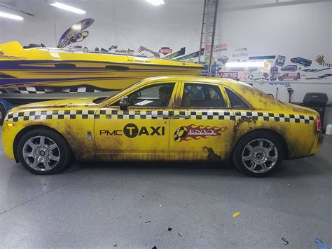 roll royce yellow rolls royce crazy taxi rust wrap wrapfolio