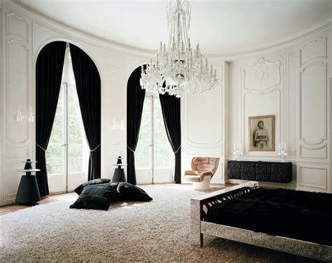 in a white room with black curtains lenny kravitz transforms his private parisian residence