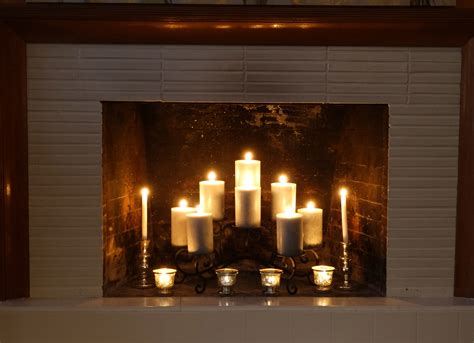 mesmerizing white candles in fireplace with grey subway