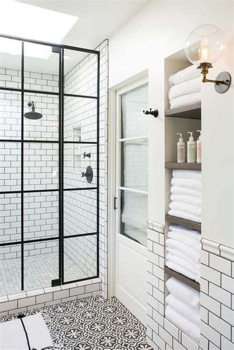 Black And White Tiles In Bathroom by Tub Clad In White Subway Tiles And Black Grout