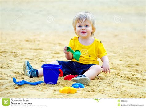 with toddlers kid in the sandpit stock image image of busy play