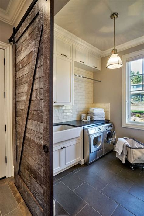 Rustic Laundry Room Featuring A Sliding Barn Door Gray Rustic Laundry