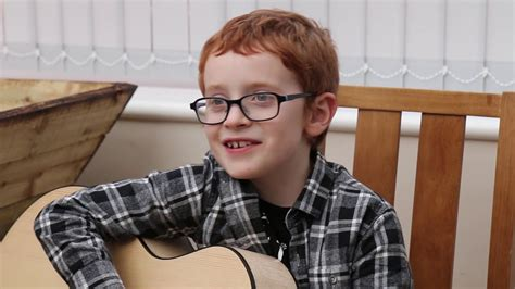 ed sheeran young a young ed sheeran playing castle on the hill on a whitby