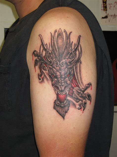 Dragon Tattoo Ripping Through Skin | 36 eye catching rip tattoos creativefan