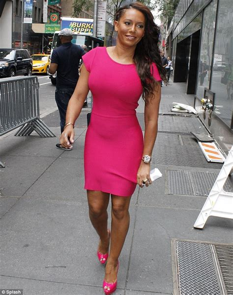 Mel Dres Pink mel b ensures she stands out in a clinging bright fuchsia
