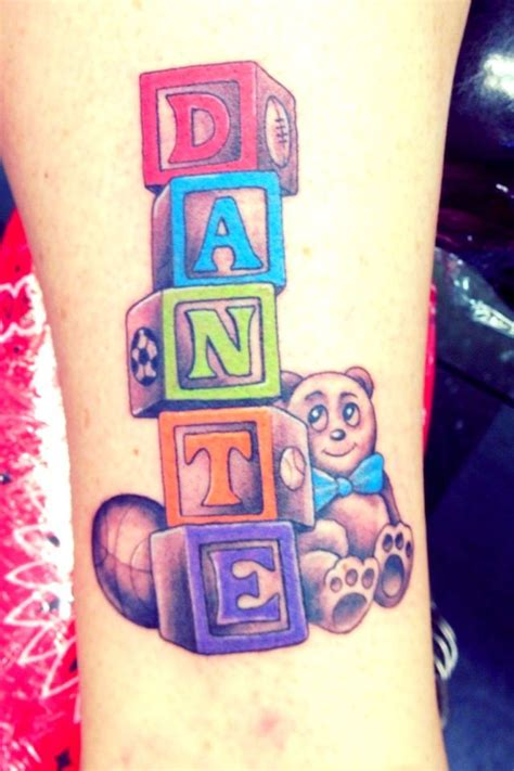 first son tattoo my s name with baby blocks lucky rabbit