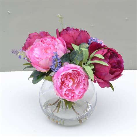 silk flowers in glass vase by abigail bryans designs
