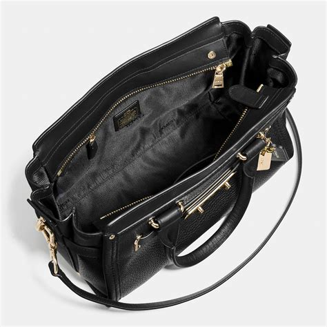 Coach Swagger Black Flower lyst coach swagger 27 in pebble leather in black
