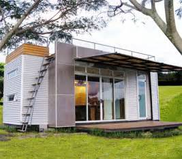 Four Lights Tiny House Company tiny glass walled container home features rooftop deck