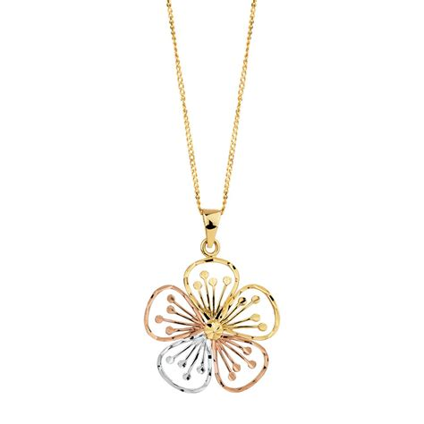 flower pendant in 10ct yellow white gold