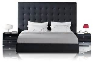 Black leather bed with tall tufted headboard contemporary bedroom
