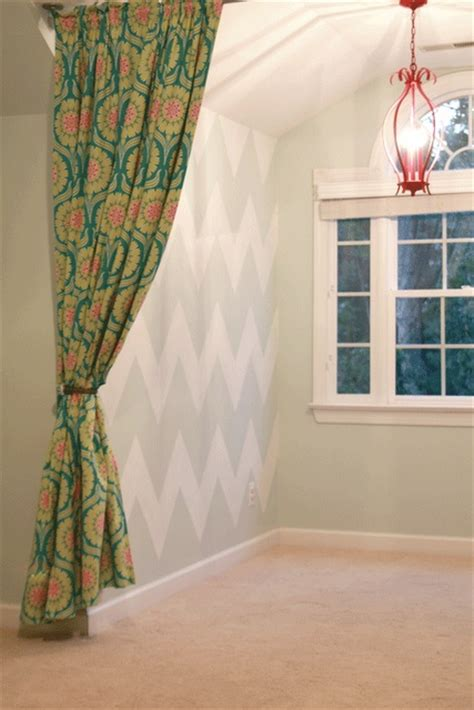 how to hang curtains from the ceiling she gives a good tutorial on how to hang pipes from the