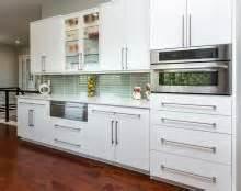 shades of amber goodbye oak cabinets hello beautiful modern white flat front kitchen cabinets with long sleek