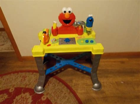 sesame street sing and giggle tool bench sesame street elmo sing giggle tool workbench by fisher