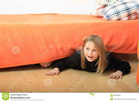 hiding under the bed children hiding under bed stock photo image 48518364