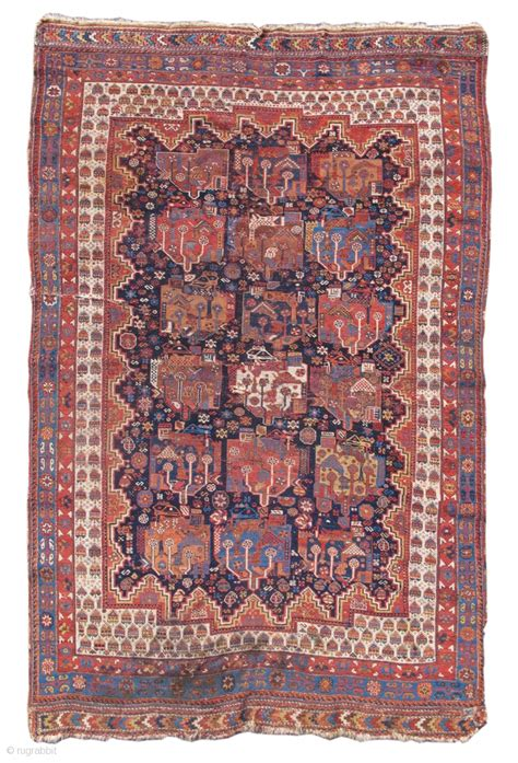 pap rugs woven with a indigo ground and playful border this afshar rug displays a repeat design of