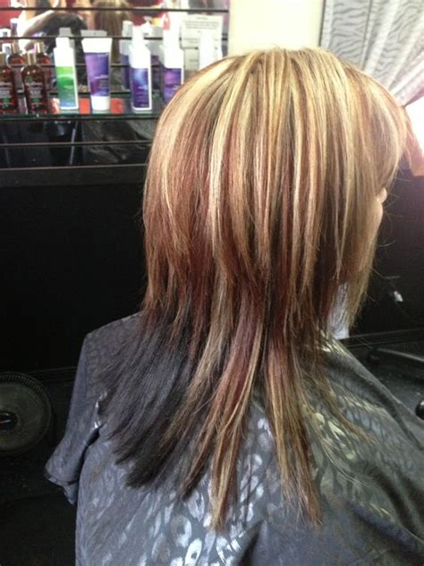 highlights with lowlights underneath reddish brown lowlight and blonde highlight with dark