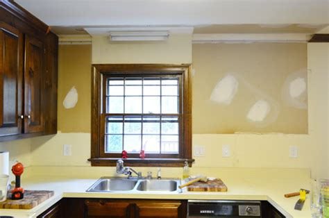 How To Take Down Kitchen Cabinets by Removing Some Kitchen Cabinets Amp Rehanging One Young